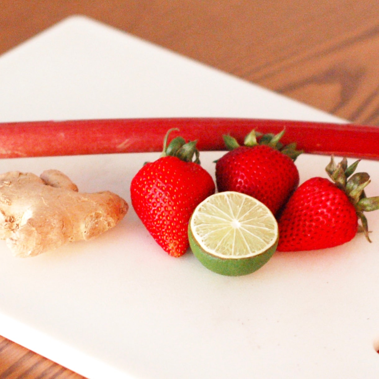 ingredients used to make a strawberry rhubarb mimosa: strawberries, rhubarb, ginger, and lime juice