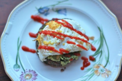 Protein- and fiber-rich black bean burgers with a kick from spicy Sriracha sauce. Serve topped with guacamole and a fried egg and a side salad or vegetable to round out the meal. @jlevinsonRD