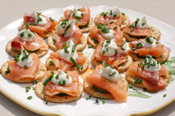 Gluten free crackers topped with cucumbers, smoked salmon, and chive crème fraîche make a great hors d'oeuvres or appetizer for any cocktail party or event. @jlevinsonrd (sponsored)
