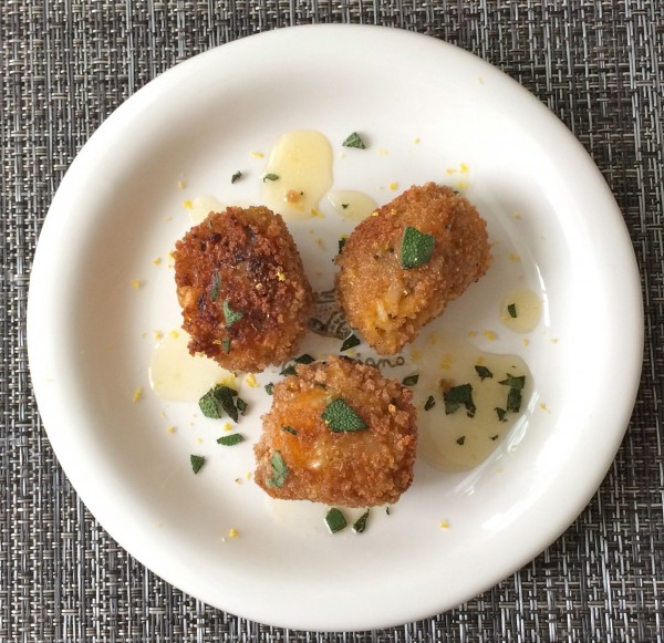 These savory brown rice balls are crisp on the outside and soft and gooey on the inside. Filled with butternut squash, fresh sage, lemon zest, and Parmesan cheese, they are an indulgent side dish or hors d'oeuvre not to be missed! @jlevinsonRD