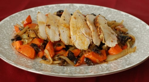 Roasted chicken with fennel, carrots, onions, and dried plums is perfectly moist, making it a great recipe for leftovers - if there are any!