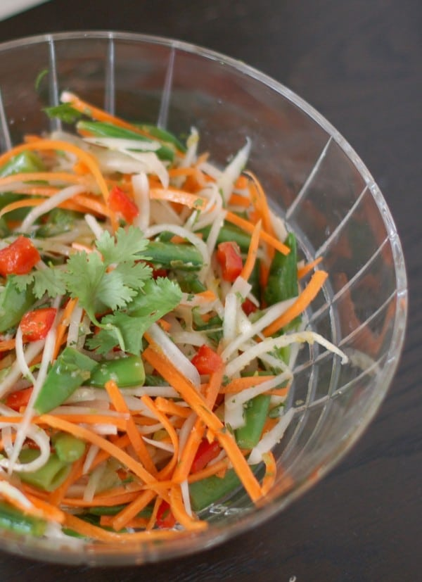 Daikon, carrots, red peppers, and snap peas come together with a lime ginger dressing in this light and refreshing Thai Citrus Salad | Nutritioulicious @JLevinsonRD