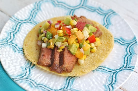 Juicy soy-marinated flank steak tacos topped with a colorful and nutritious nectarine corn salsa brimming with the flavors of summer @jlevinsonrd