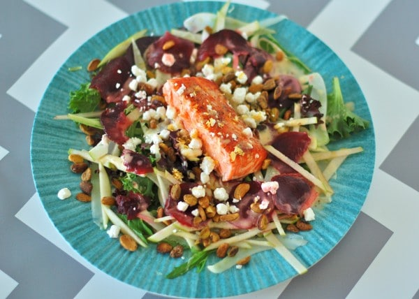 This Salmon Waldorf Salad combines mixed greens, ruby red beets, crisp fennel and green apple, crunchy pistachios, creamy goat cheese, and heart-healthy salmon with a citrus yogurt vinaigrette. A nutritious and delicious twist on the classic Waldorf salad. @jlevinsonRD