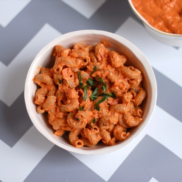 Quick & Easy Creamy Roasted Pepper and Tomato Pasta | Sweet roasted red peppers, savory sun-dried tomatoes, protein and fiber-rich chickpeas, and ricotta cheese come together to make this creamy sauce that perfectly coats your favorite pasta. A dish the whole family - kids included - will love! Get this vegetarian recipe @jlevinsonrd.