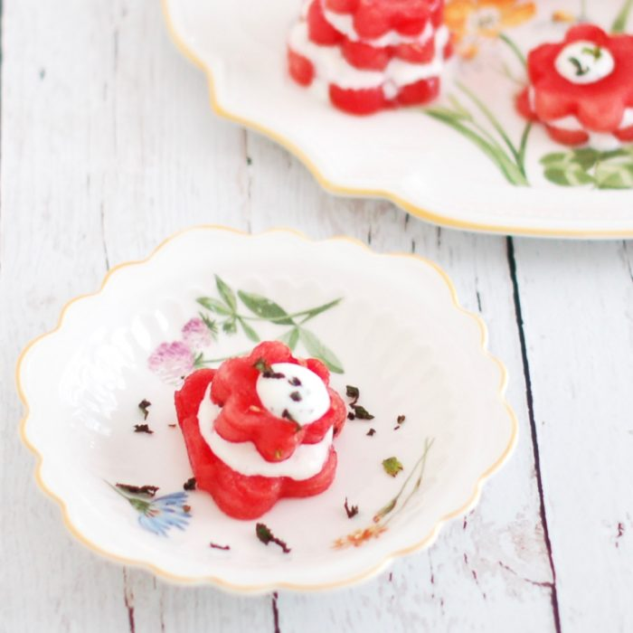 Watermelon & Lemon Mint Ricotta Stacks | Creamy and zesty lemon mint ricotta is sandwiched between stacks of watermelon flowers for a festive, nutritious and delicious summer appetizer or hors d'oeuvres. Get the vegetarian and gluten-free recipe @jlevinsonrd.