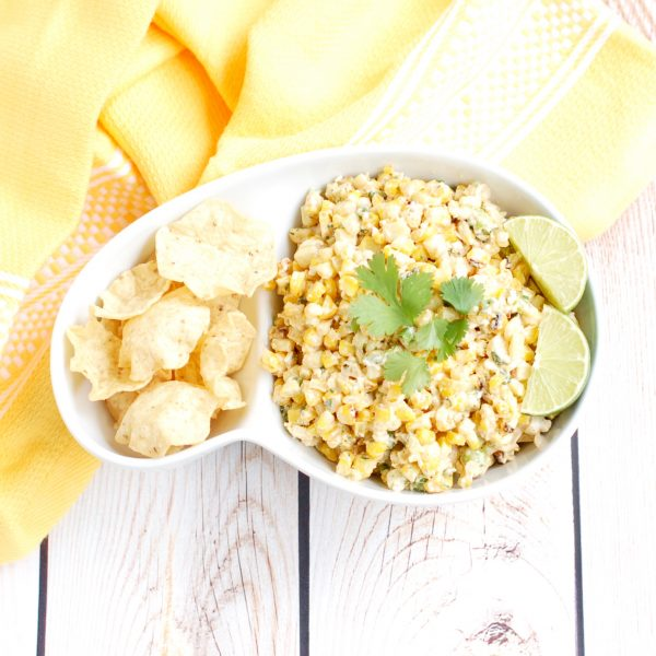 Esquites (Mexican Street Corn Salad) | This lighter version of a classic Mexican street food is made with low-fat plain yogurt instead of mayonnaise to save on calories without sacrificing flavor. Serve as an appetizer with corn chips or as a side dish for your next Taco Tuesday. Recipe @jlevinsonrd.