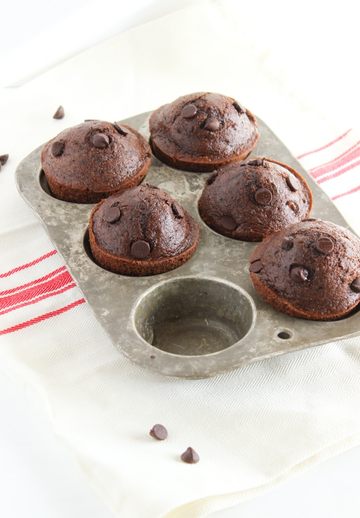Whole Grain Double Chocolate Muffins | Delicious whole grain muffins with a double dose of chocolate that taste sinful but aren't! A great make-ahead breakfast treat or healthier dessert. Get the vegetarian and nut-free recipe @jlevinsonrd.