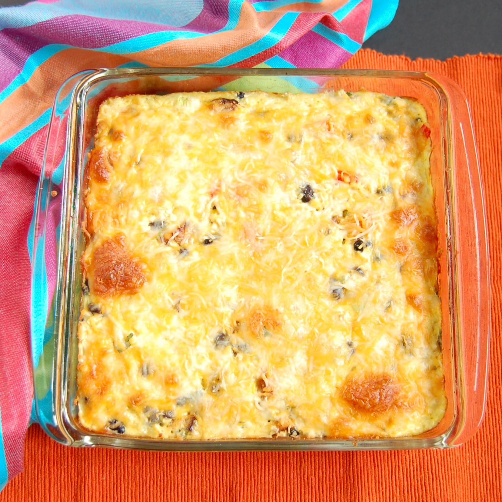 Feed your hungry family in an hour with this one-dish Southwestern Cauliflower Rice Casserole packed with veggies, protein, and flavor! Get the gluten-free, grain-free, and vegetarian recipe @jlevinsonrd.