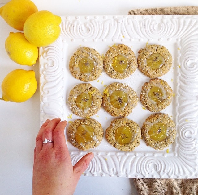 Welcome spring with this sweet and tangy Lemon Poppy Seed Thumbprint Cookie recipe! Soft and chewy lemon poppy seed cookies are dolloped with zesty lemon curd and a simple glaze for the perfect springtime treat. Get the vegetarian and nut-free recipe @jlevinsonrd.