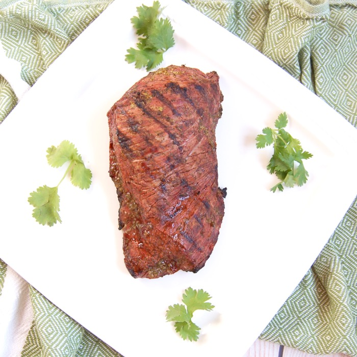 Perfectly grilled Cilantro Lime Steak is easy to make and a delicious entrée to serve guests at your summer barbecue. Recipe via JessicaLevinson.com | #Glutenfree #dairyfree #steak #beef #kosher #grilling #recipe #cilantro #lime