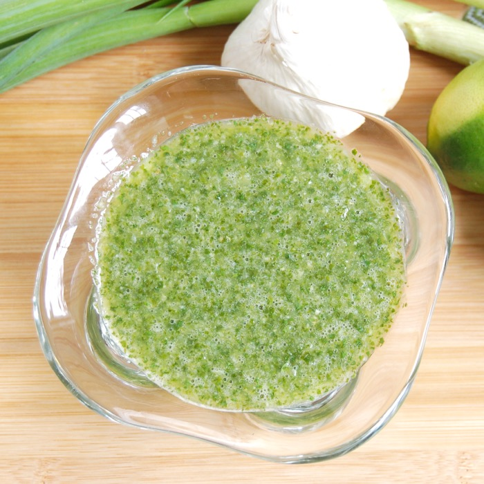 Cilantro, lime, scallions, and garlic are pureed into this delicious cilantro lime marinade perfect for tenderizing a cut of beef.