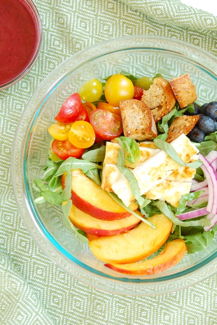 Juicy peaches, ripe tomatoes, briny halloumi cheese, and crunchy rustic bread come together in this Peach Panzanella Salad, a twist on a classic Tuscan summer dish. Get the vegetarian recipe @jlevinsonrd.