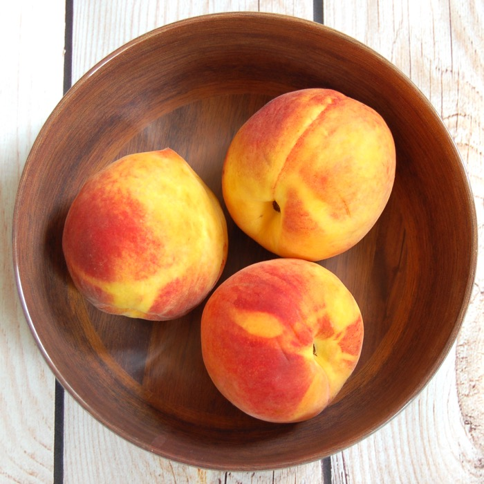 juicy ripe peaches used in a summer peach panzanella salad