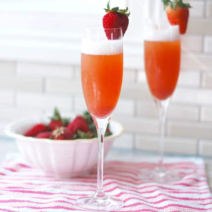 Strawberry Rhubarb Mimosa in champagne flutes