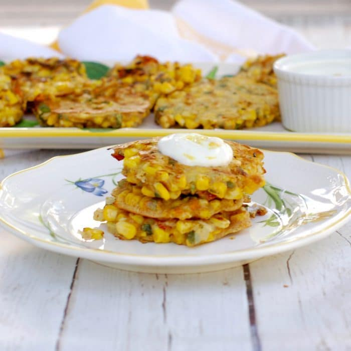 Corn & Basil Cakes Stacked on Plate