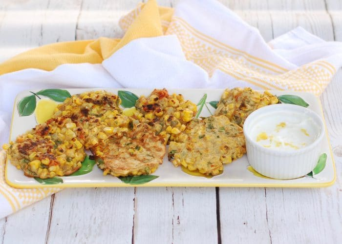 Corn & Basil Cakes on Tray with Sauce