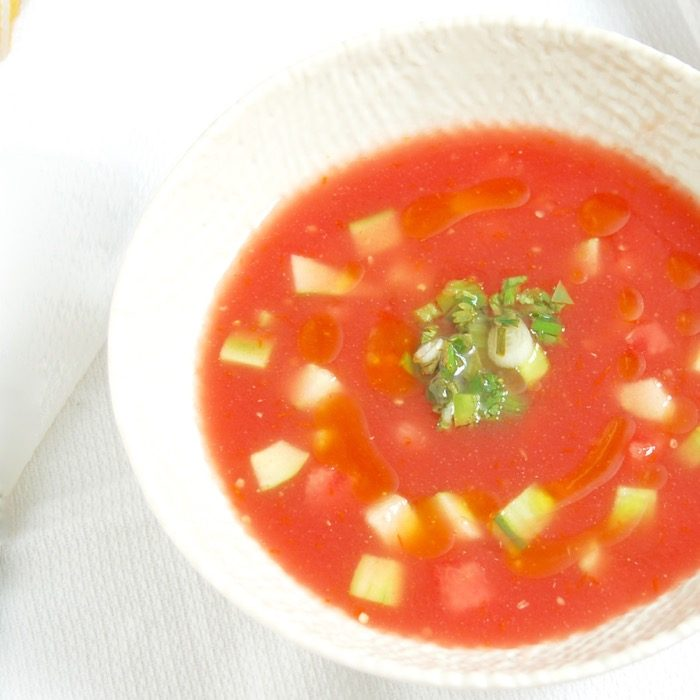 Enjoy the best flavors of summer by the spoonful with this Watermelon Tomato Gazpacho, a sweet and savory twist on the classic summer soup.Get the recipe at JessicaLevinson.com | #glutenfree #vegan #dairyfree #watermelon #tomatowellness #summereats #gazpacho