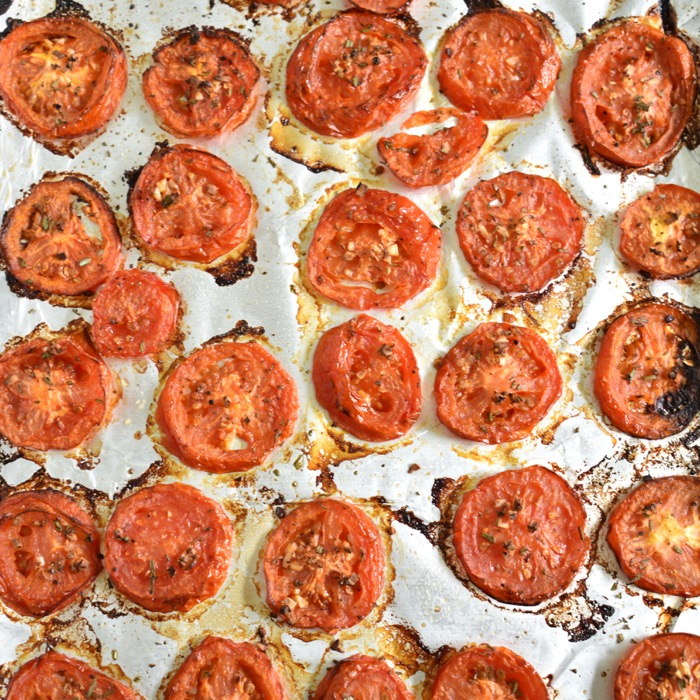 roasted tomatoes on baking sheet