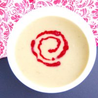 Parsnip pear soup is sweet, savory, and creamy without any cream. A delicious addition to a fall or winter meal. Tart cranberry coulis provides an elegant topping and flavorful contrast to the sweetness of the soup. Serve as an appetizer or in smaller servings as a festive holiday party hors d'oeuvre. Get this vegan and gluten-free recipe at Small Bites by Jessica.