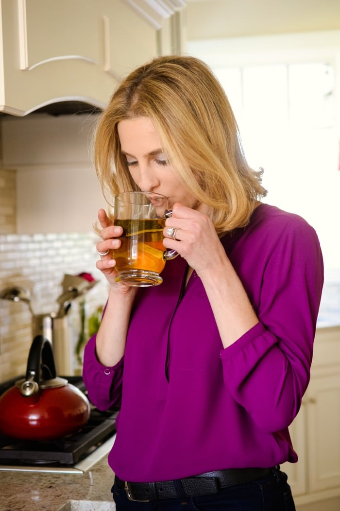 woman drinking cup of hot tea