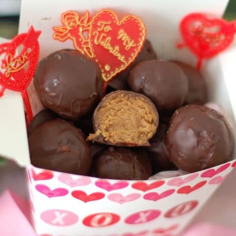 Rich & creamy chocolate peanut butter truffles are a decadent treat made healthier with Greek yogurt, maple syrup, natural peanut butter, & dark chocolate.
