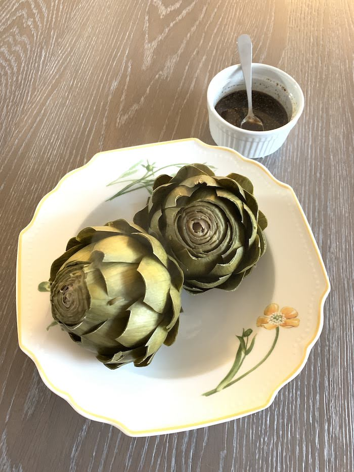 steamed artichokes in bowl with balsamic vinaigrette