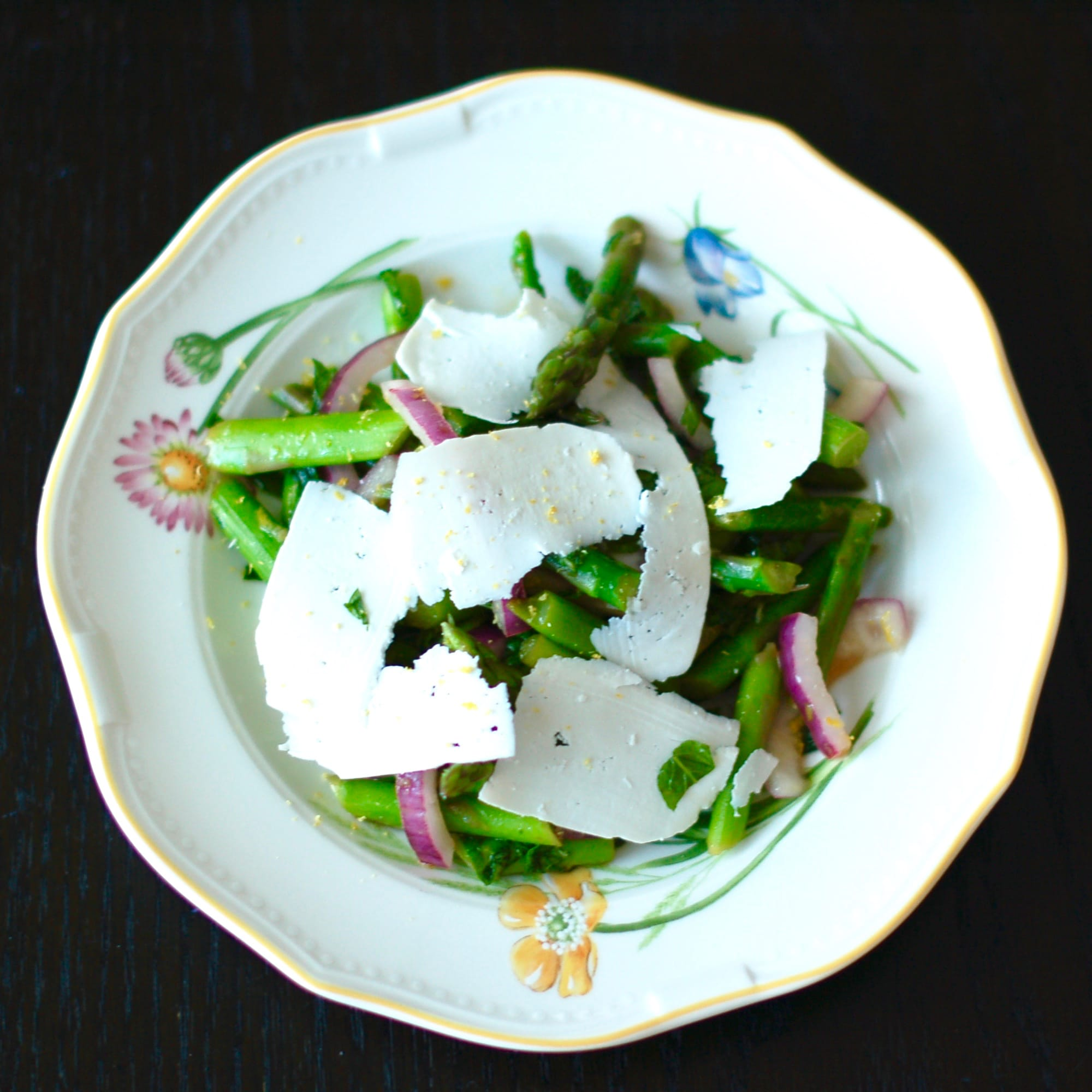 Earthy asparagus is tossed with crisp red onions, refreshing mint, zesty lemon, and salty ricotta salata cheese in this Asparagus Mint Salad that will get you in the spirit of spring and wake up your taste buds. Get the recipe at JessicaLevinson.com. #vegetarian #glutenfree #asparagus #springrecipes #salad