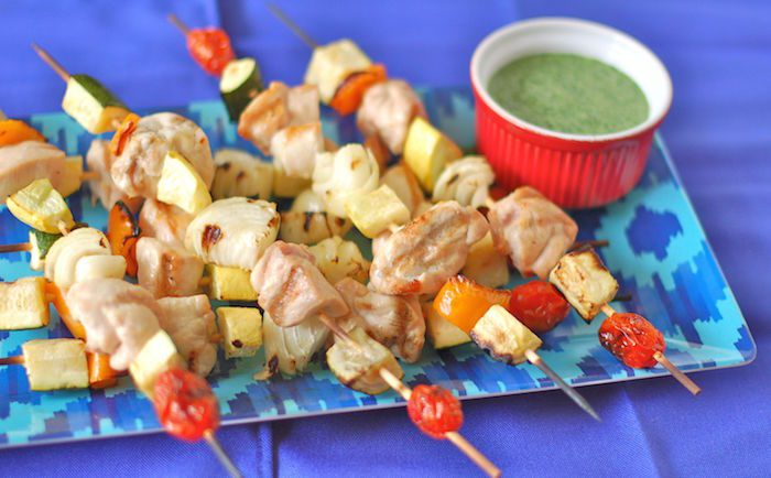 Veggie and protein-packed, these chicken kebabs with herb sauce are the perfect summer dinner on the grill! via JessicaLevinson.com | #glutenfree #dairyfree #chickenrecipes #kosher #grillingrecipes #summerrecipes #healthyrecipes