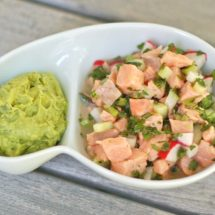 Salmon Ceviche with Cucumbers in serving bowl with guacamole