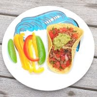 The whole family can participate in taco night with these smoky chipotle beef tacos topped with cooling guacamole and watermelon salsa! Get the gluten-free, dairy-free, and family-friendly recipe @jlevinsonrd.