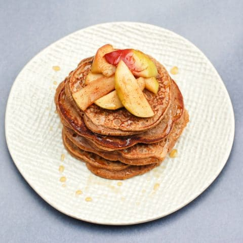 Take your favorite snack duo to breakfast or brunch with these apple peanut butter pancakes topped with sautéed cinnamon apples. #eggfree #vegetarian #pancakes #peanutbutter #applesandpeanutbutter #breakfast #healthyrecipes