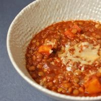 Hearty Vegetable Lentil Chili   Warm up with a bowl of hearty lentil chili that's packed with vegetables and brimming with flavor and nutrition. Enjoy topped with shredded cheese or mashed avocado. Get the vegan and gluten-free recipe @jlevinsonrd.