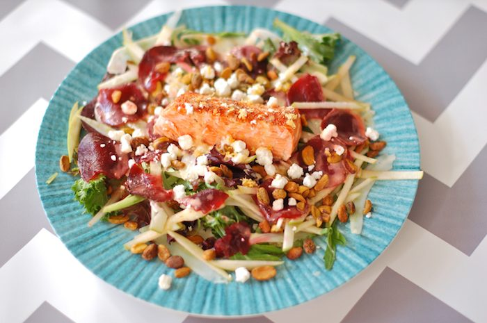 This Salmon Waldorf Salad combines mixed greens, ruby red beets, crisp fennel and green apple, crunchy pistachios, creamy goat cheese, and heart-healthy salmon with a citrus yogurt vinaigrette. A nutritious and delicious twist on the classic Waldorf salad. #glutenfree #salmon #salad #waldorfsalad #beets #fennel #goatcheese