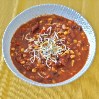 This gluten-free and dairy-free three bean vegetarian chili will warm you up and nourish you from the inside out throughout the cold days of winter!