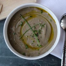 Satisfy your cravings for an umami-rich meal with this gluten-free and vegetarian thick and creamy pureed mushroom soup - no cream added! #mushroomsoup #mushroomrecipes #soup #glutenfree #vegetarian