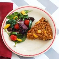 Heart-healthy oats are combined with sun-dried tomatoes, baby spinach, thyme, and creamy goat cheese in this savory baked oatmeal frittata. Get this Gluten free and vegetarian recipe @jlevinsonrd.
