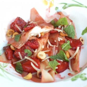 lemon ricotta filled ravioli with roasted strawberries and hazelnuts