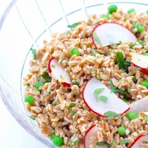 spring farro salad in cut glass serving bowl