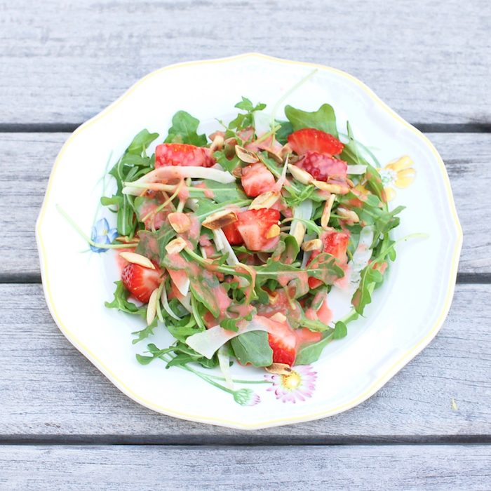 Strawberry Arugula Salad with Fennel, Toasted Almonds, and Strawberry Champagne Vinaigrette is a fresh and sweet salad for the spring and summer. Via JessicaLevinson.com | #salad #strawberries #glutenfree #veganfriendly #vegetarian #dairyfree