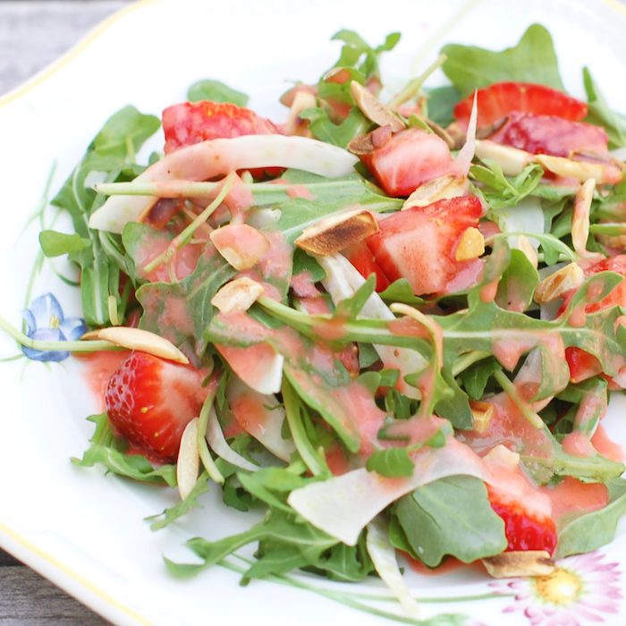 Strawberry Arugula Salad with Fennel, Toasted Almonds, and Strawberry Champagne Vinaigrette is a fresh and sweet salad for the spring and summer. Via JessicaLevinson.com | #salad #strawberries #glutenfree #vegetarian #veganfriendly #dairyfree