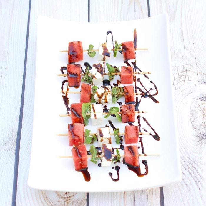 watermelon feta mint skewers on serving platter