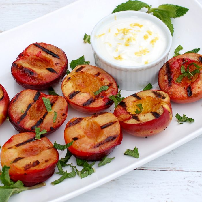 Grilled Stone Fruit with Honey Lemon Yogurt Sauce is a naturally delicious, low-calorie, vegetarian and gluten-free way to end to your summer BBQ. Get the recipe at JessicaLevinson.com | #stonefruit #grilledfruit #vegetarian #glutenfree #easyrecipe #grilling #summer #barbecue #bbq #peaches #plums #nectarines
