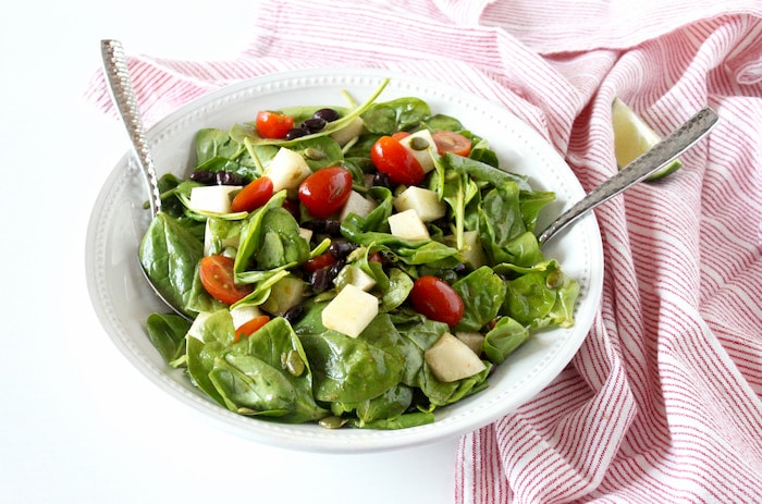 spinach salad with jicama in bowl