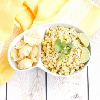 This lighter version of the classic Esquites Mexican street corn salad is made with low-fat plain yogurt instead of mayonnaise to save on calories without sacrificing flavor. Serve as an appetizer with corn chips or as a side dish for your next Taco Tuesday, Cinco de Mayo celebration, or weekend barbecue. Get the recipe at JessicaLevinson.com | #vegetarian #glutenfree #corn #mexicancorn #recipemakeover #healthyrecipes #summerrecipes