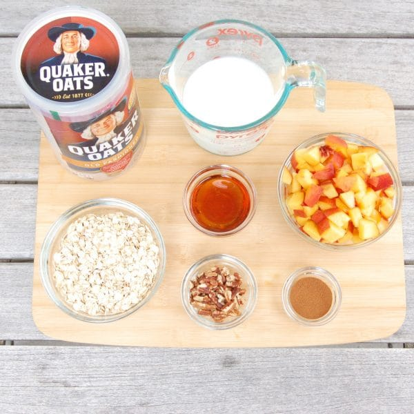 Maple-roasted peaches top creamy kefir-soaked oats in this easy make-ahead Peaches and Cream Overnight Oats breakfast recipe perfect for rushed mornings. #vegetarian #kidfriendly #healthyrecipe #breakfast #overnightoats #peaches