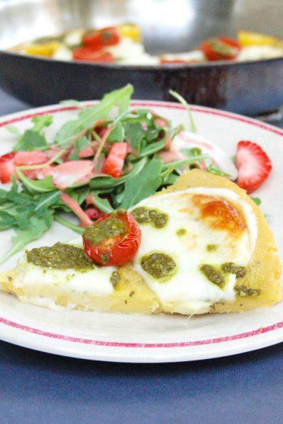 Farinata with Tomato Mozzarella and Pesto on Plate