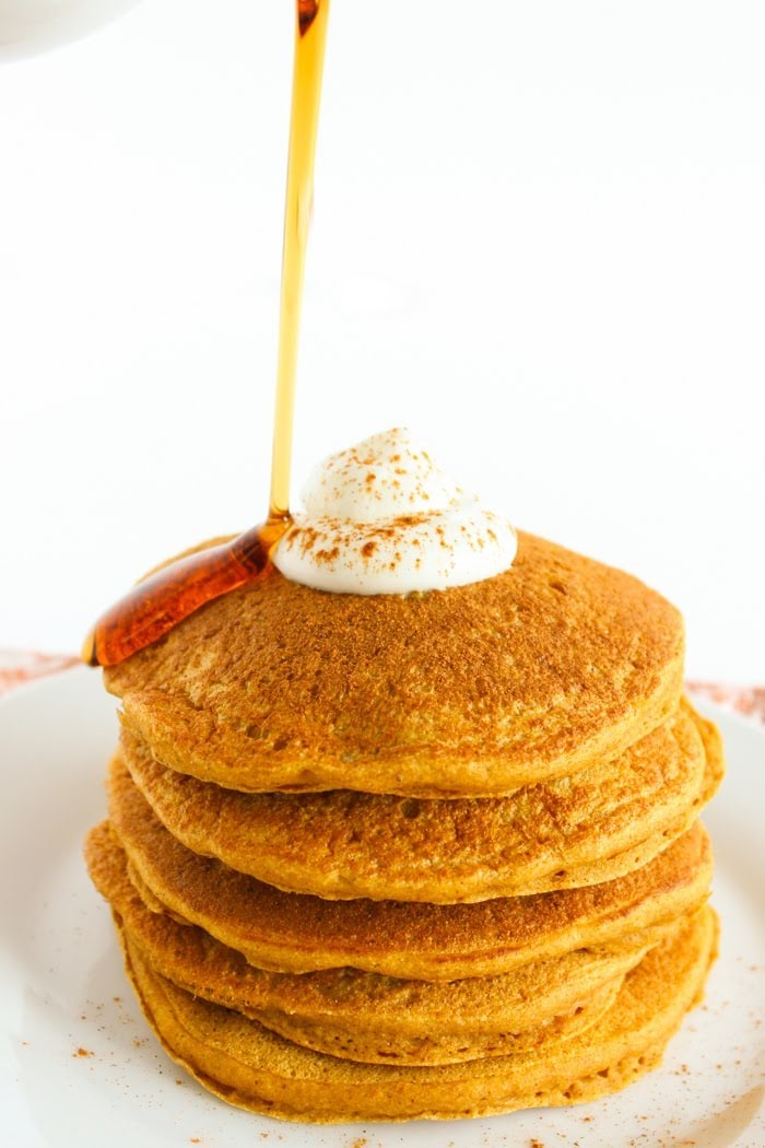 Healthier Pumpkin Pancakes with Syrup Pour