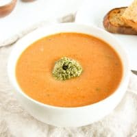Warm up this fall and winter with a bowl of tomato white bean soup topped off with a dollop of kale pesto. Gluten free, vegetarian, and vegan-friendly.