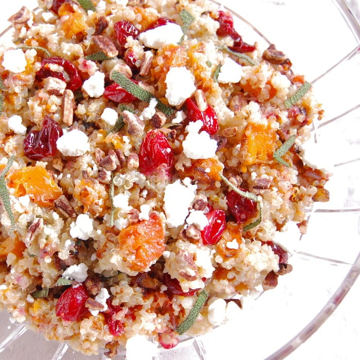 roasted butternut squash and cranberry quinoa salad topped with goat cheese and pecans for a protein boost